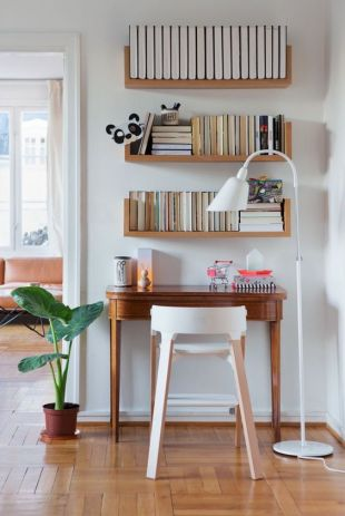 Floating shelves with built-in bookends.