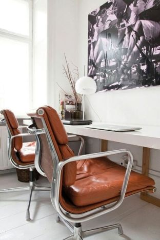 Terracotta office chairs bring great color change to a simple office.