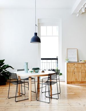 Pendant light over a dining table.