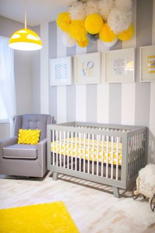 A modern nursery decorated with yellow and grey colors.