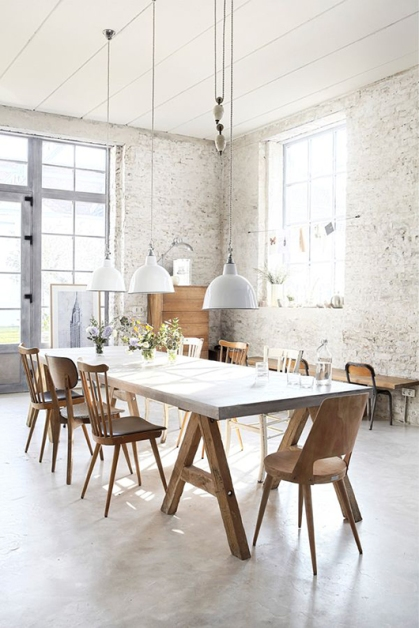 Juxtapose a sophisticated marble table with wooden chairs.