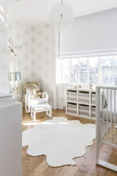This splendid gender-neutral nursery proves that when it comes to decorating, white and beige is truly a no-fail color combination.