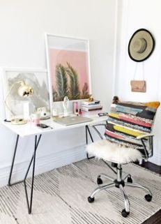 A whimsical work space accented with metallic lighting.