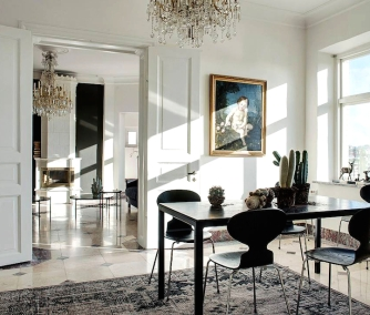 Modern dining chairs and table contrast this classical home.
