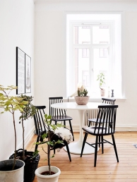 Pair a minimal round table with thick black wooden chairs for the ultimate contemporary look.