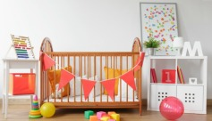 Add a splash of personality to an otherwise neutral nursery with one or two brightly colored accessories.
