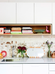 Renew a dated back splash by adding glossy cupboards and fresh colorful accents.