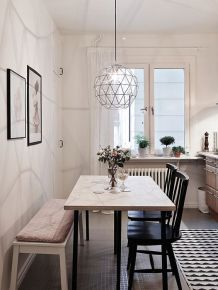 Bright hanging lights and a large windowsill create the perfect dining room.
