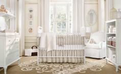 A cream white baby nursery with romantic shabby chic décor.