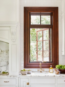 A thick wooden framed window adds a touch of traditional.
