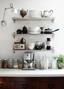 Modernize your kitchen with open shelving to show off dinnerware.
