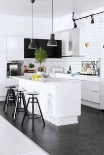 A minimalist kitchen is inadequate without it's complimentary hanging lights.
