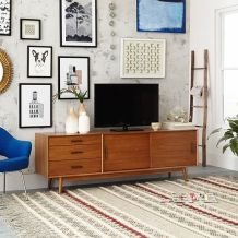 A mid-century media console effortlessly emphasizes this living room.