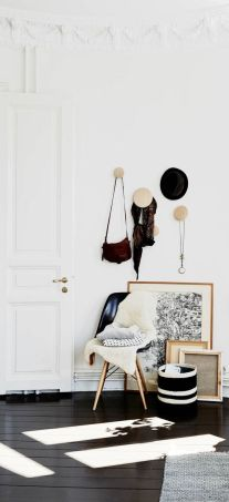 Wooden wall hooks are a simple way to jazz up your entryway.