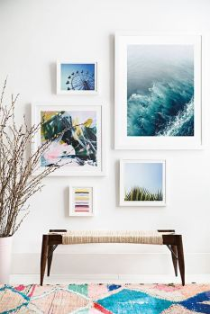 An ocean artwork softens the front hard wood side chair.