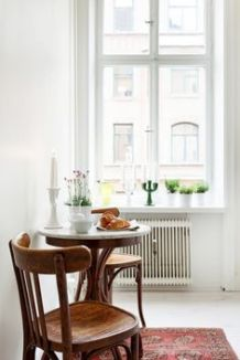A tiny dining area with natural lighting.