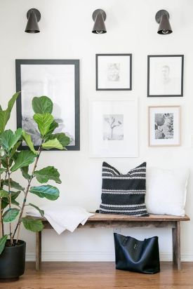 Invite guests to take off their shoes by styling a bench with pillows.
