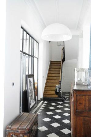 Simple lighting balances a bold entryway.