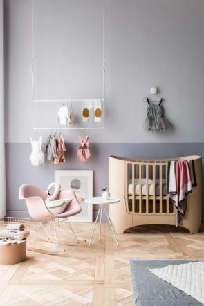 A plush pink and purple nursery.