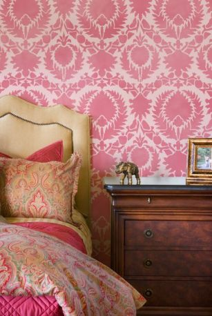 These bold red walls craft an appearance that enriches the remaining red hues through the space.