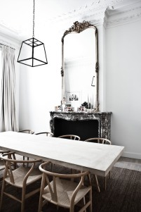 A minimal dining set creates balance between a busy room.