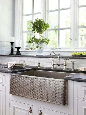 Stainless steel farm sink with hints of green.
