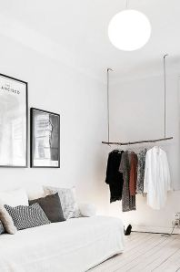 Showcase your style with a hanging, wooden clothing rack.