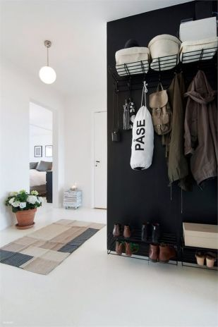 This dark wall acts as a divider between the entryway and the exterior closet.