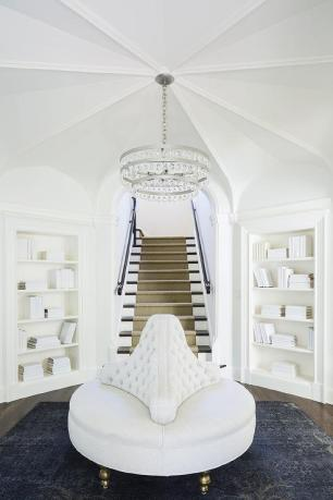 An oversized chandelier adds elegance to this minimal area.
