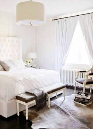 Traditional bedroom mixed with winter white accents.