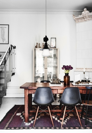 A wooden table mixed with plastic chairs increases a dining room's urban appeal.