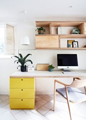 An office space adorned with a yellow filing cabinet.
