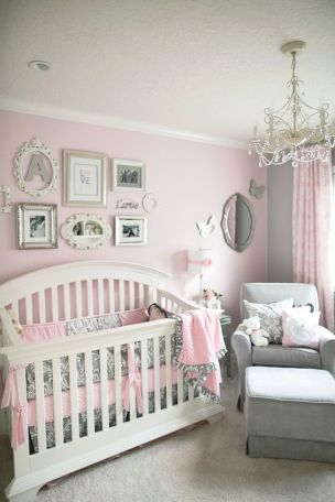A soft and elegant grey and pink nursery.