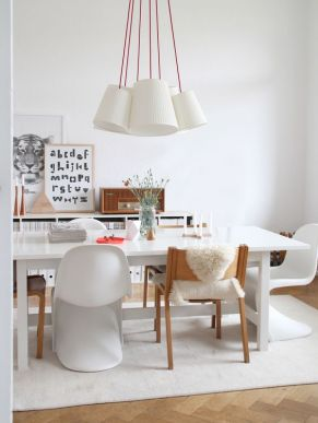 Create charisma with mix-matched chairs and statement hanging lights.