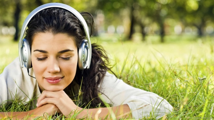 girl-in-park-with-headphones