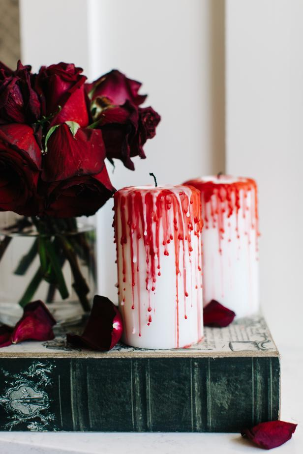 ci-rennai-hoefer_halloween-spooky-mantel-roses-bloody-candles2-jpg-rend-hgtvcom-616-924